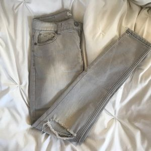 Distressed gray jeans
